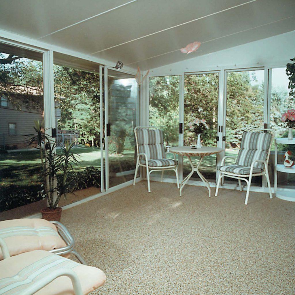 Sun room stone and epoxy flooring option for Walkout basement sunroom