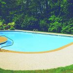 Outdoor Inground Pool with Nature Stone Flooring Surround